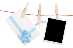 Instant photo, gift letter and pacifier hanging on the clothesli. Ne. Isolated on white background Stock Image