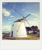 Instant photo old windmill in Vejer de la Frontera Stock Image