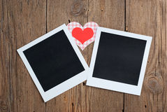 Instant photo with paper hearts Royalty Free Stock Photos