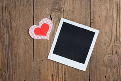 Instant photo with paper hearts Stock Images