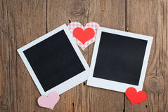 Instant photo with paper hearts Royalty Free Stock Image