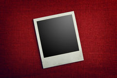 Instant photo on red background. A blank instant photo on a red background Stock Images