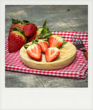 Instant photo of strawberries Royalty Free Stock Image