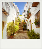 Instant photo of typical street in Frigiliana, Stock Photo