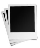 Instant photographic film. Three instant photographic film prints isolated on white background Stock Image