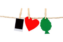 Instant photographs and heart tree shapes hanging Stock Images