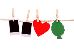 Instant photographs and tree heart shapes hanging Stock Photo