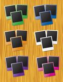 Instant photos on wood background Royalty Free Stock Photo
