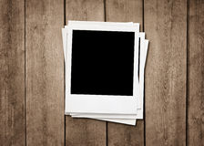 Instant photos at wooden background Royalty Free Stock Images