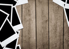 Instant photos at wooden background Stock Image