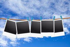 Instant picture on the clothesline Stock Photography