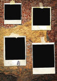 Instant picture frames. Blank,battered instant picture frames, on a rusty iron wall,free space for pix Stock Images