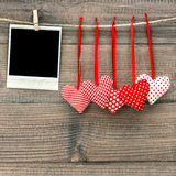 Instant polaroid photo frame and red hearts. Valentines Day Royalty Free Stock Photos