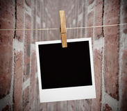 Instant print transfer hung with peg Royalty Free Stock Photography