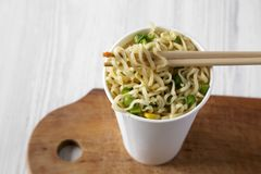 Instant ramen noodles with beef flavoring in a paper cup, low angle view. Close-up. Instant ramen noodles with beef flavoring in a paper cup, low angle view royalty free stock photo