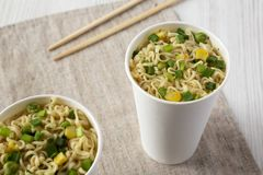 Instant ramen noodles with beef flavoring in paper cups, low angle view. Close-up. Instant ramen noodles with beef flavoring in paper cups, low angle view royalty free stock photos