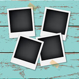 Instant vintage photos frames. On the old wooden background. Retro vector background Royalty Free Stock Photography