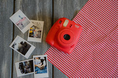 The instax camera on wooden background Royalty Free Stock Image