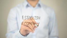 Institua uma empresa, escrita do homem na tela transparente imagens de stock royalty free
