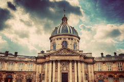 Institut de France in Paris. Famous cupola, dome against clouds Royalty Free Stock Photos