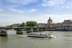 Institut de France and the Pont des Arts bridge across river Sei Stock Photos