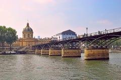 Institut de France and pont des Arts, Seine River in Paris. View of the Institut de France and pont des Arts, pedestrian bridge which crosses the River Seine stock photography