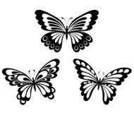 inställda svarta fjärilar tatuerar white Arkivfoto