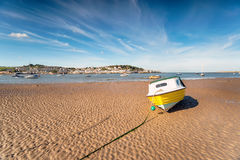 Instow in Devon. A yellow boat on the beach at Instow in Devon royalty free stock photography
