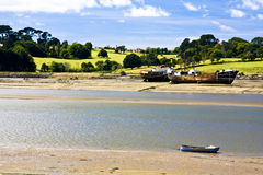 Instow tranquillity. English country river scene with abandoned steam ships on sand bank Stock Images