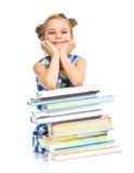Instrução - menina engraçada com livros. Fotografia de Stock