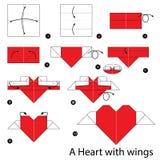 Instrucciones paso a paso cómo hacer el corazón de la papiroflexia con las alas Fotos de archivo libres de regalías