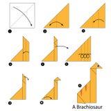 Instrucciones paso a paso cómo hacer el dinosaurio de la papiroflexia A Fotos de archivo