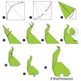 Instrucciones paso a paso cómo hacer el dinosaurio de la papiroflexia A Foto de archivo