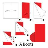 Instrucciones paso a paso cómo hacer papiroflexia botas Fotografía de archivo libre de regalías