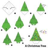 Instrucciones paso a paso cómo hacer papiroflexia un árbol de navidad Fotografía de archivo