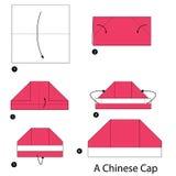 Instrucciones paso a paso cómo hacer papiroflexia un casquillo chino Imagenes de archivo