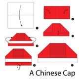 Instrucciones paso a paso cómo hacer papiroflexia un casquillo chino Foto de archivo