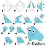 Instrucciones paso a paso cómo hacer papiroflexia un elefante Foto de archivo libre de regalías