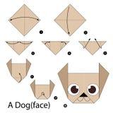 Instrucciones paso a paso cómo hacer papiroflexia un perro Fotografía de archivo libre de regalías