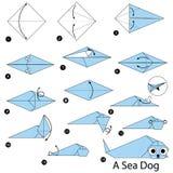 Instrucciones paso a paso cómo hacer papiroflexia un perro de mar Imagen de archivo libre de regalías