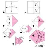 Instrucciones paso a paso cómo hacer papiroflexia un pescado Imagenes de archivo
