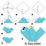 Instrucciones paso a paso cómo hacer papiroflexia una nutria de mar Imagen de archivo libre de regalías