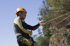 Instructeur de descente de canyon Photographie stock