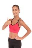 Instructeur heureux de forme physique faisant le signe correct Photos stock