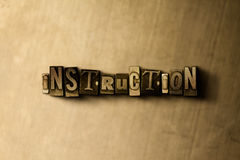 INSTRUCTION - close-up of grungy vintage typeset word on metal backdrop Stock Photo