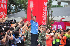 Instruction gun fired instantly. Half international marathon in fushui county in yunnan province in China, time: on September 25, 2013 Stock Photos