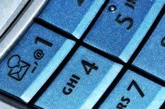 Instruction-macro bleu de clavier de téléphone portable Photo stock