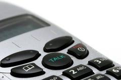 Instruction-macro sans fil de téléphone sur le blanc photographie stock
