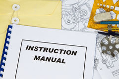 Instruction Manual. Of a machinery with engineering tools stock images