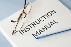 Instruction manual. On blue background royalty free stock images